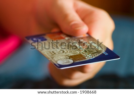 Hand holding credit cards. Small DOF.