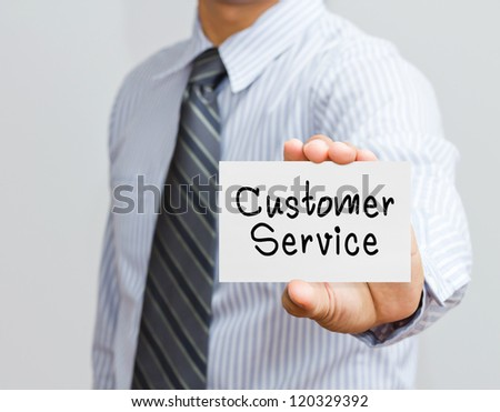 hand holding customer service card