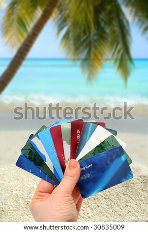 hand holding different plastic cards used for travel