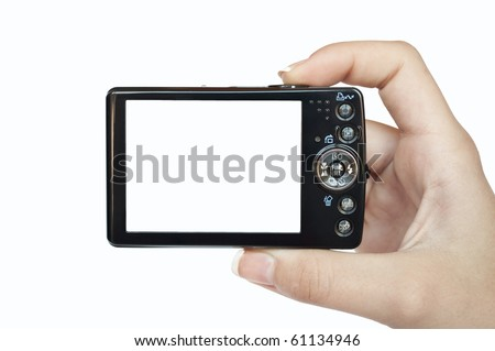 Hand holding digital camera rear view. Empty space for your picture or text. - stock photo