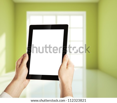 hand holding digital tablet with plan  house
