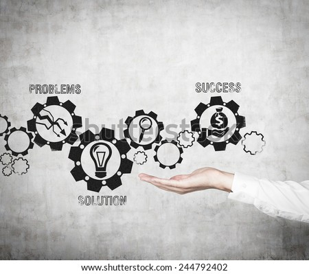 hand holding drawing gears with business icons #244792402