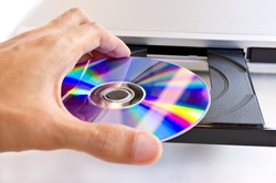 hand holding dvd insert to dvd player