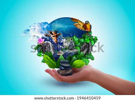 Hand holding Earth engulfed in leaves, cute wild animals, lush greenery – leaves and water. Protect the environment and Earth day concept