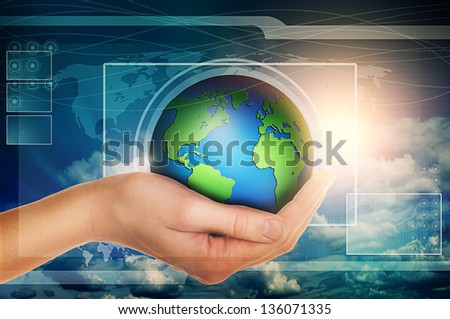hand holding earth globe in blue virtual interface with clouds