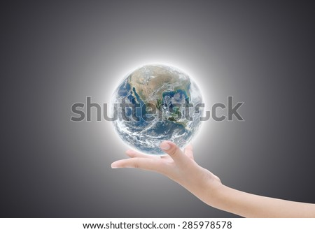 Hand holding earth on black and light  background ,concept background , Elements of image are furnished by NASA