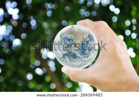 Hand holding earth on bokeh background , Elements of image are furnished by NASA