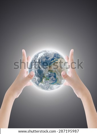 Hand holding earth on dark light background ,concept background , Elements of image are furnished by NASA