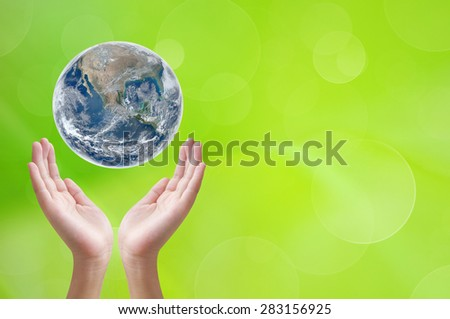 Hand holding earth on green background ,concept background , Elements of image are furnished by NASA
