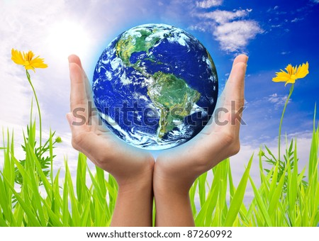 hand holding earth, saving earth concept. Earth globe image provided by NASA