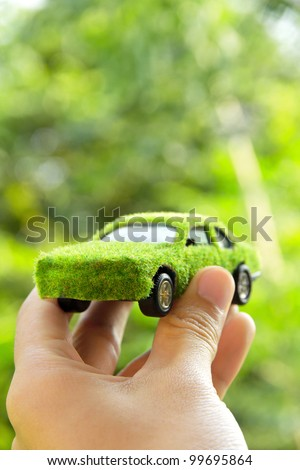 Hand Holding Eco car icon concept