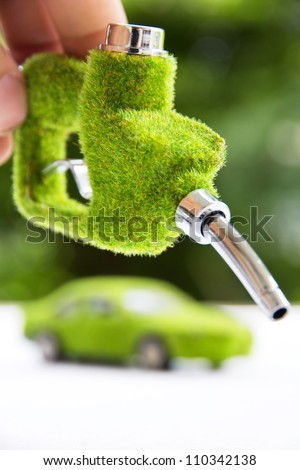 hand holding eco fuel nozzle,energy concept