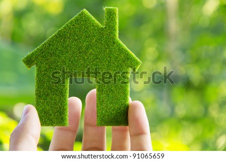 hand holding eco house icon concept #91065659