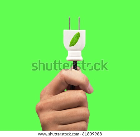 hand holding eco power plug and leaf logo with green background