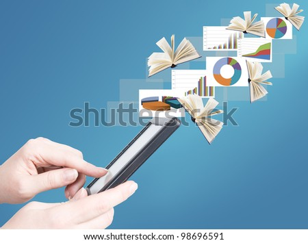 Hand holding electronic book and opened books and business diagrams flying away (education and business news concept)