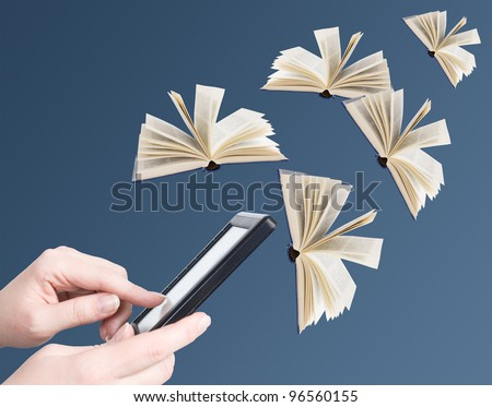 Hand holding electronic book and opened books flying away (education concept)