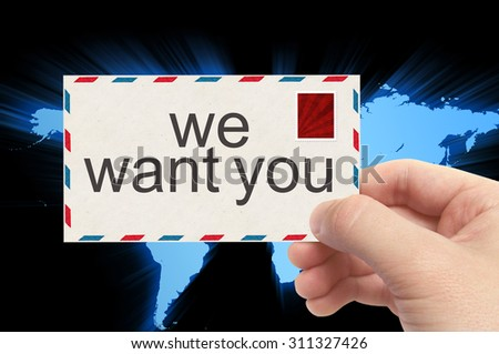 hand holding envelope with we want you word on world background.