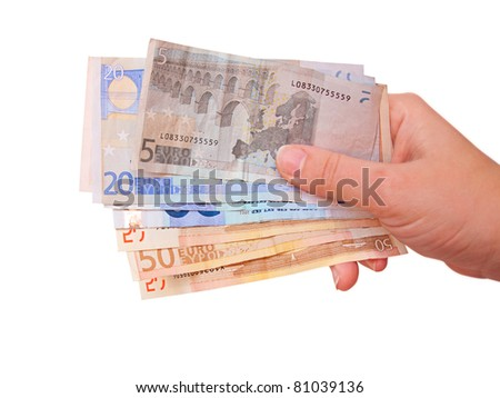 Hand holding euro bills, isolated in white - stock photo