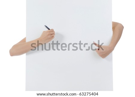 Hand holding fountain pen against the background of the billboard. Isolated on white background