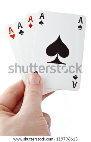 Hand holding four aces over a white background.