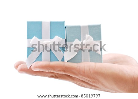Hand Holding 2 Gift Boxes