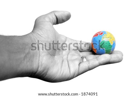 Hand holding globe of the Earth