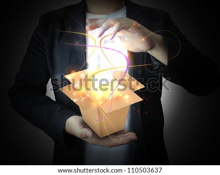 hand holding Glowing Magic box - stock photo