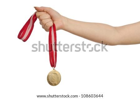 Hand holding gold medal on white