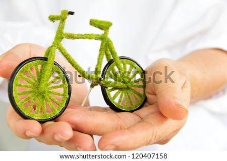 Hand Holding green bicycle