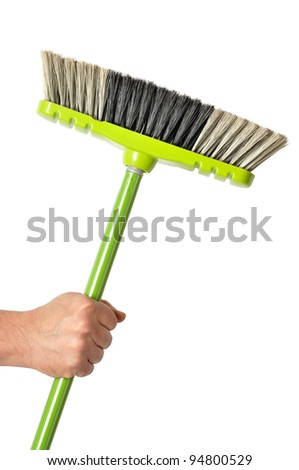 Hand holding green broom isolated on white background