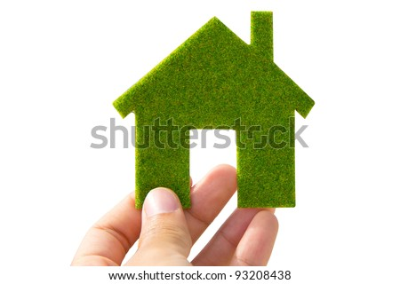 hand holding green Eco house icon concept