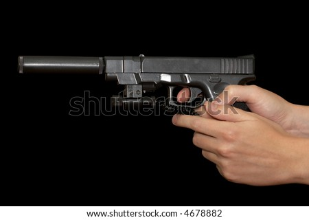 hand holding gun, glock 17 with holster