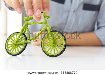 Hand Holding handcraft green bicycle