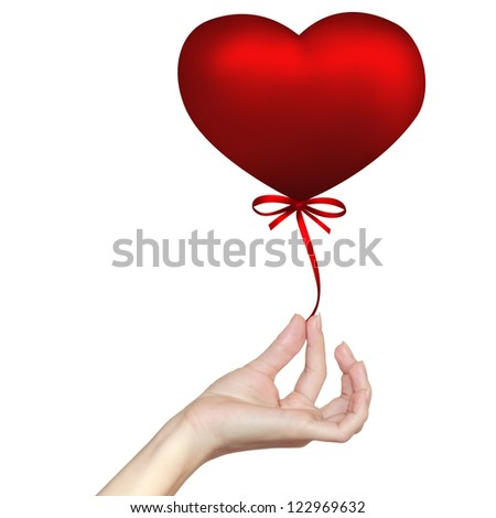 Hand holding heart with ribbon bow isolated on white background