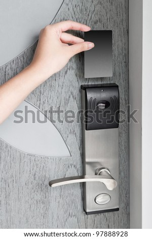 Hand holding hotel key card to enter the room