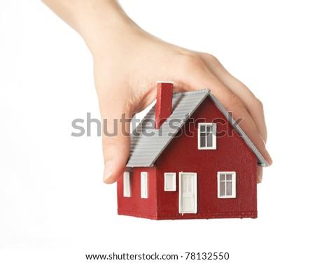 Hand holding house - stock photo