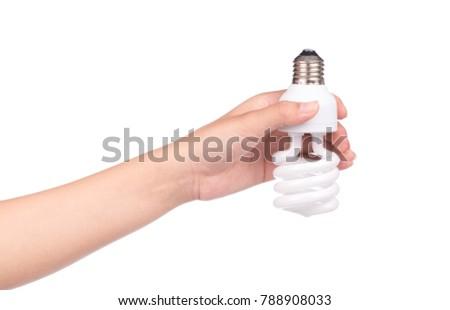 hand holding Illuminated light bulb isolated on white background