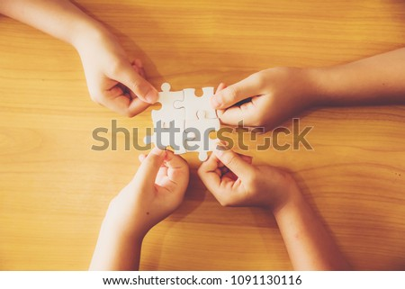 Hand holding jigsaw puzzles, Business partnership concept. #1091130116