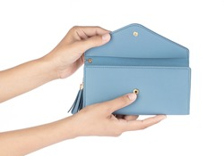 Hand holding leather blue wallet purse isolated on white background