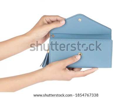 Hand holding leather blue wallet purse isolated on white background Foto stock ©
