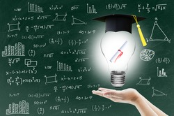 hand holding light bulb with certification for graduation shows the ingenuity intelligence knowledge and success for education on blackboard.