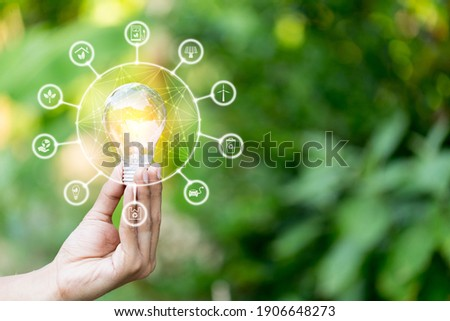 Hand holding light bulb with icons energy sources for renewable,love the world concept. Photo stock ©