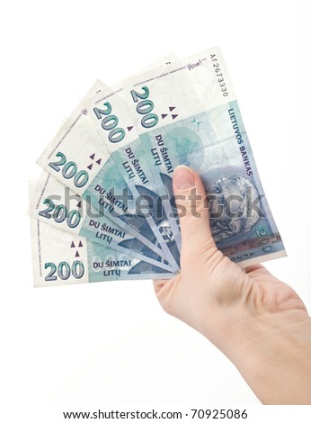 hand holding Lithuanian money litas banknotes