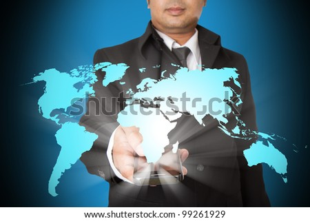Hand holding magic phone and world map
