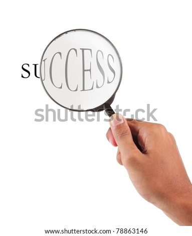 hand holding magnifier glass with success text