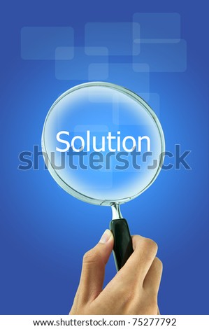 Hand holding magnify glass with word solution