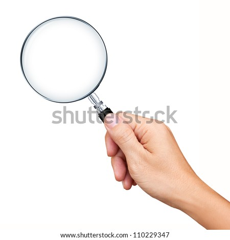 Hand holding magnifying glass isolated on white background