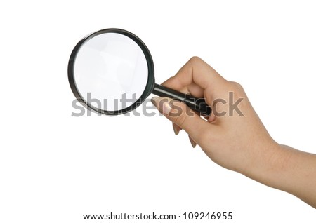 Hand holding magnifying glass on white