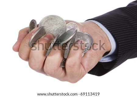 Hand holding many  coins