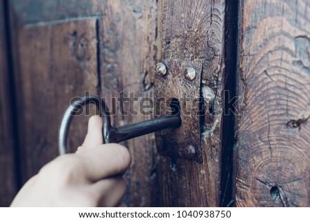 hand holding metal vintage key...